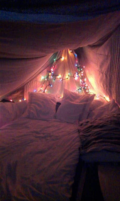 christmas lights in a canopy bed pictures photos and