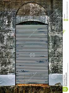 Steel Curtain Security Door On Abandoned Factory Stock