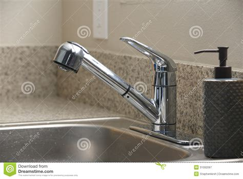 clean stainless steel kitchen sink empty clean kitchen sink and soap dispenser royalty free