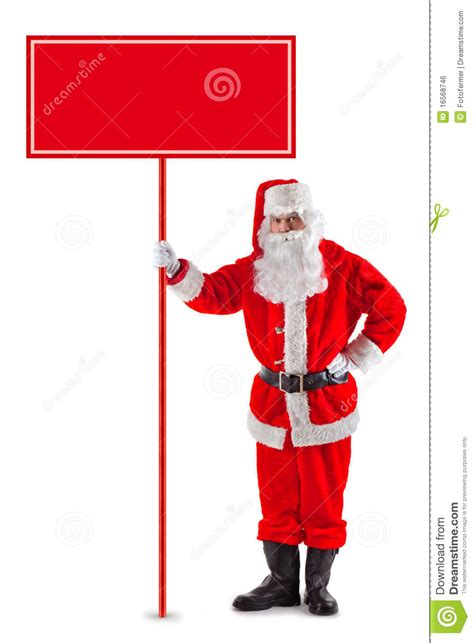 standing santa claus with a sign royalty free stock image