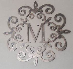 family initial monogram inside a metal scroll with any With metal monogram letters for wall