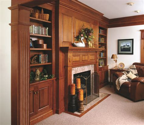traditional cherry fireplace mantel and bookshelves