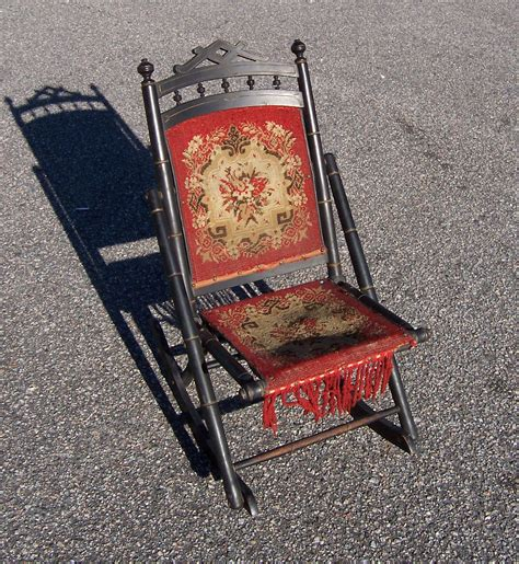 a resale antique sewing folding rocking chair