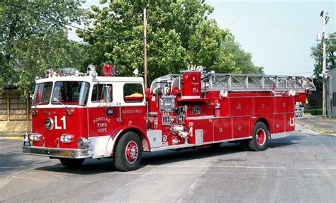 Pontiac, IL L-1. A mid-mount ladder with a master stream ...