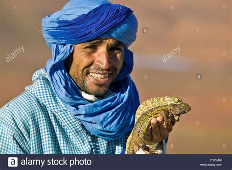 Berber Man Morocco With Desert Chameleon And Agama Lizard