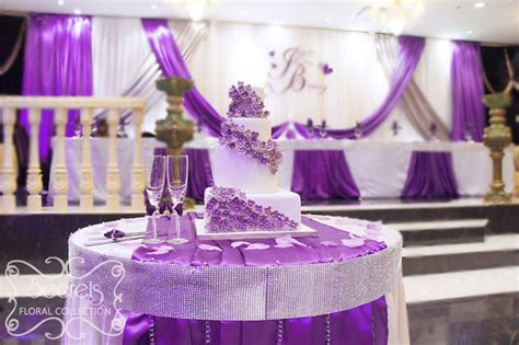 purple silver and white wedding decorations cake table decorated with white crinkled linen and purple satin purple wedding cake table