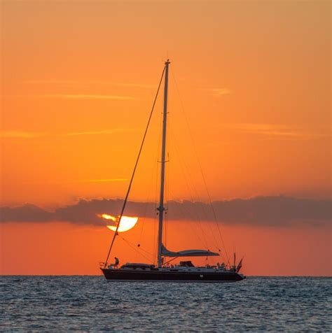Sailboat On Water by Sailboat On Of Water During Sunset 183 Free Stock Photo