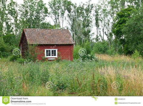 traditional swedish red house  summer landscape stock