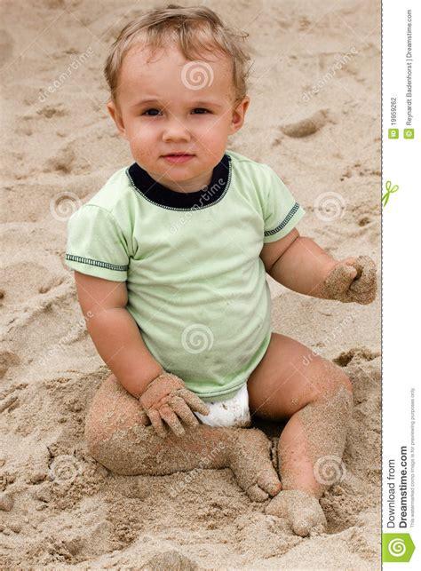 baby boy  beach sand stock photography image