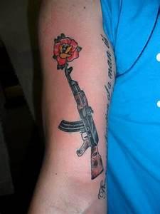 Gangsta gun tattoo on right arm - Tattoos Book - 65.000 ...