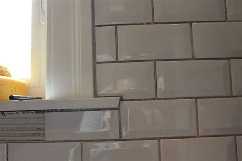 subway tile around window with wood sill & skirt   Kitchen