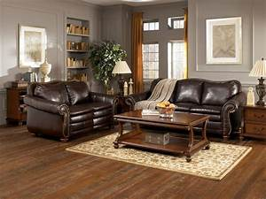 Warm living room design with black iron frame fireplace for Black and brown furniture in living room