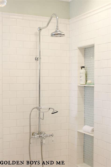 white shower tile golden boys and me master bathroom pedestal tub white subway tile carrera