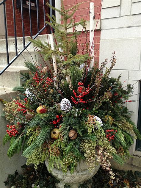 christmas urn   full mixed greenery pine cones