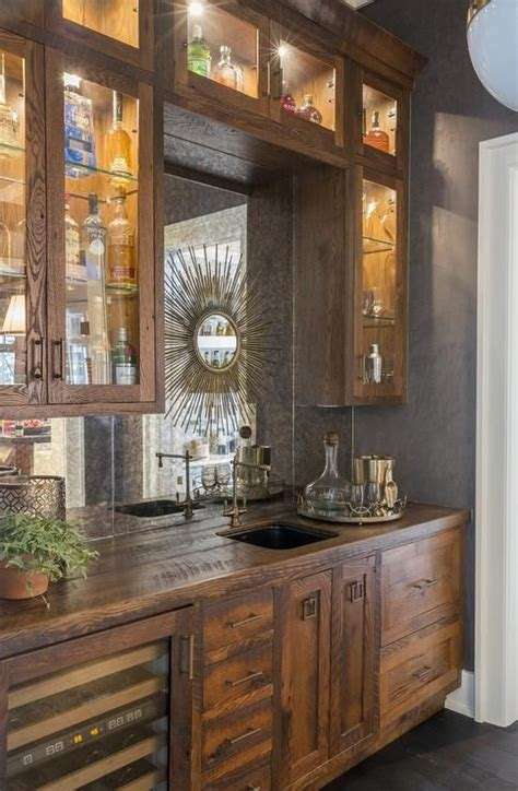 rustic wet bar features rustic cabinets fitted
