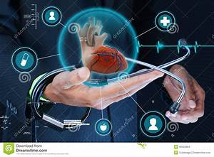 Smart Hand Showing Human Heart And Stethoscope Stock Photo