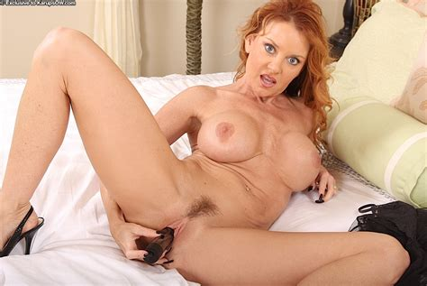 Busty Redhead Wearing Black Sexy Lace Lingerie Sticking A