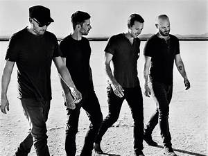 After initially balking, Coldplay's new album will hit ...  Coldplay