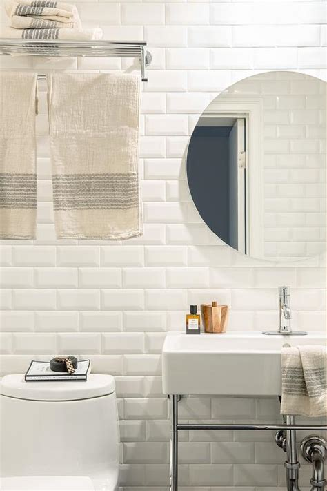 white bathroom with white beveled subway tiles