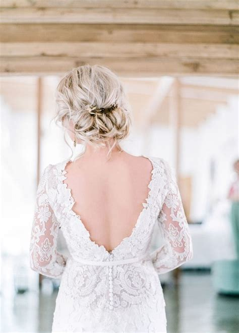 low chignon bridal wedding hairstyle and backless wedding