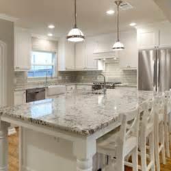 white glass subway tile kitchen backsplash white granite countertops and glass subway tile backsplash but with grey cabinets