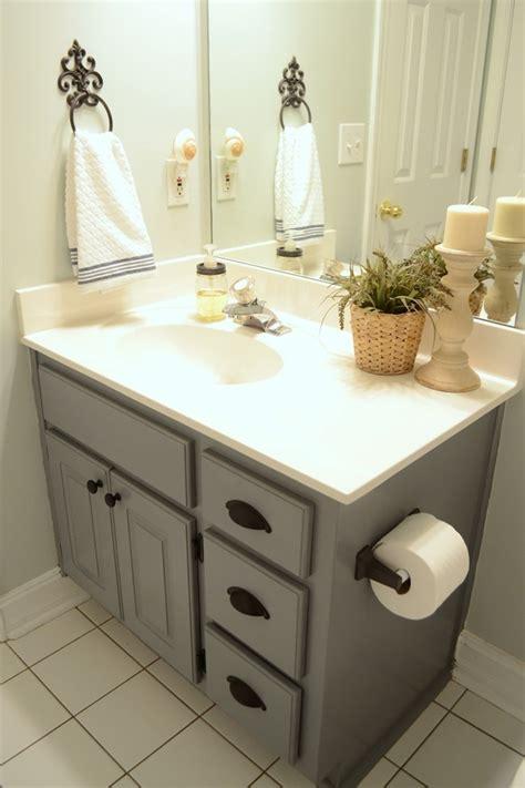 guest bathroom update � stained wood framed bathroom mirror