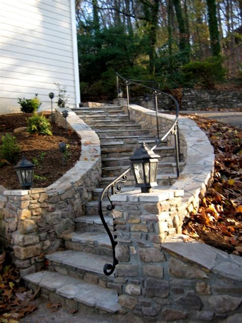 steps with custom curved railing with elaborate