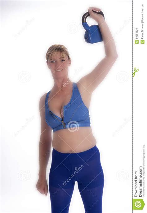 exercising kettle bell using woman bending health