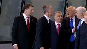 President Donald Trump appears to physically push aside ...