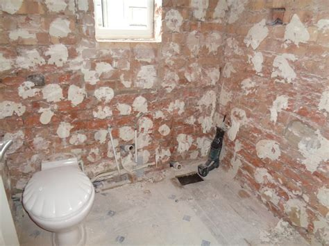 Removing Bathroom Tiles by Bathroom Converted To A Shower Room With Bathroom Storage