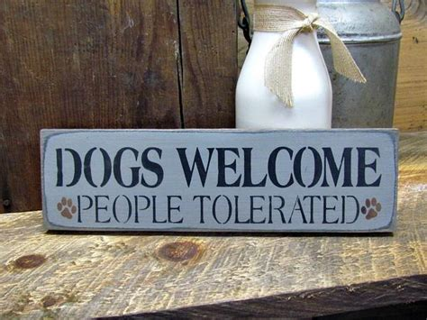 dogs  people tolerated wooden sign   pet