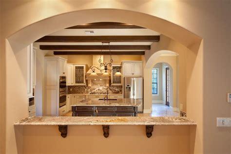 arch kitchen design framed arch breakfast bar in tuscan style kitchen hgtv 1329