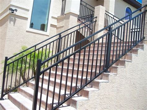 Concrete Staircase With Black Metal Handrails Outdoor