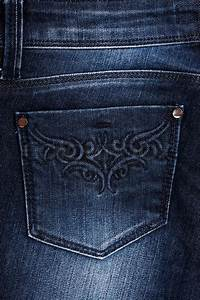 Back pocket on jeans with a yellow embroidery | Stock Photo | Colourbox