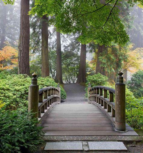 wooden foot bridge in a japanese garden wall mural 7 5