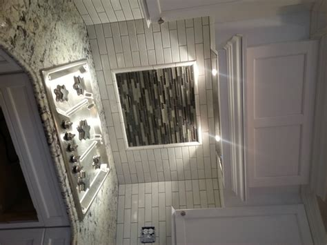 glass subway tiles for kitchen backsplash high drama kitchen bath design studio the cabinetry
