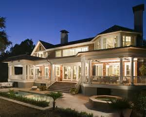 house plans with front and back porches ignore the beautiful lighting the pools of water in front of the house the wraparound porch