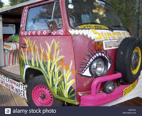 volkswagen hippie van front front detail of old flower child vw bus with lot of hippie
