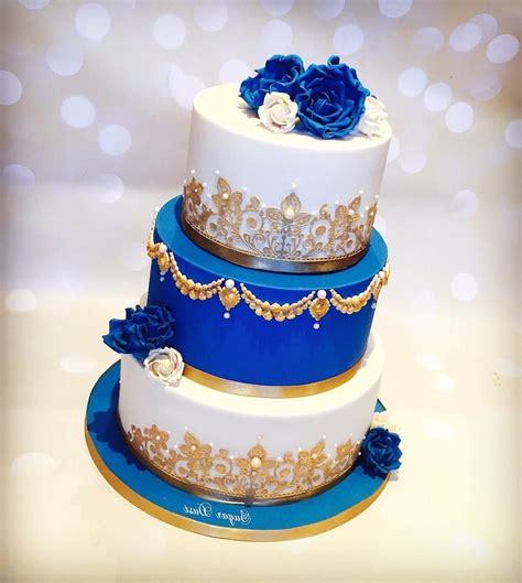 wedding cakes royal blue  gold wedding dress ivory