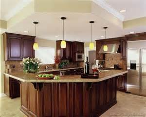 luxury kitchen islands a luxury kitchen with cherry cabinets and a large angular island bar and matching soffit