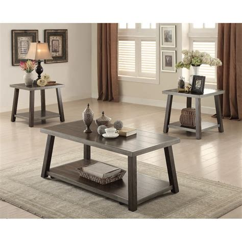 First, avoid coffee table books on coffee tables; Canora Grey Rondeau Reclaimed Wood Look 3 Piece Coffee Table Set | Wayfair