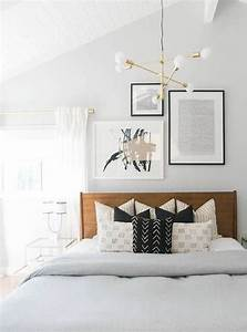 Modern guest room decor with brass light fixture and