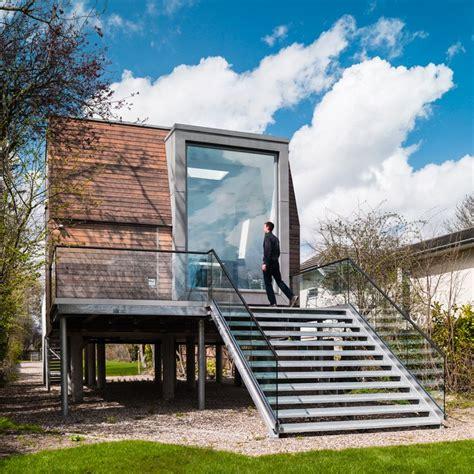 ben adams architects elevates chiquet flood house  weybridge