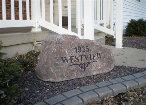 custom monuments  landscaping  signs