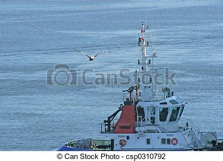 Garbage Scow Picture by Stock Photo Of Garbage Scow Boat Offloading Garbage From