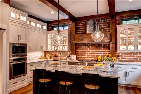 kitchen with brick brick wall in kitchen with white cabinets glass cabinet doors to exposed brick gray accent in