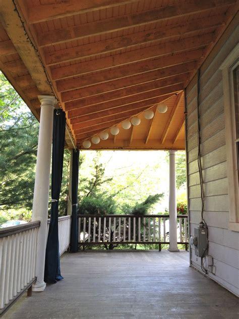 victorian wrap  porch porch ceiling exposed beams