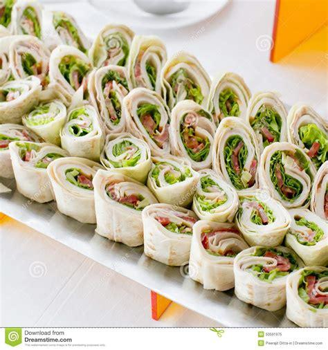 cuisine appetizer plate of many mini bite size sandwich appetizers stock