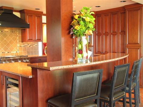 Raised bar seating on curved island   Traditional