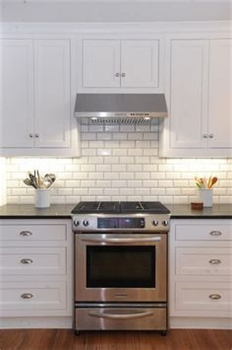 kitchen pro cabinets white cabinets honed slate counter tops and black handles 2467